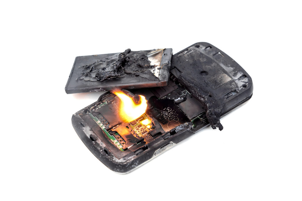 mobile-phone-battery-explodes-and-burns-due-to-overheat-danger-of-using-smart-phone-copyrights-