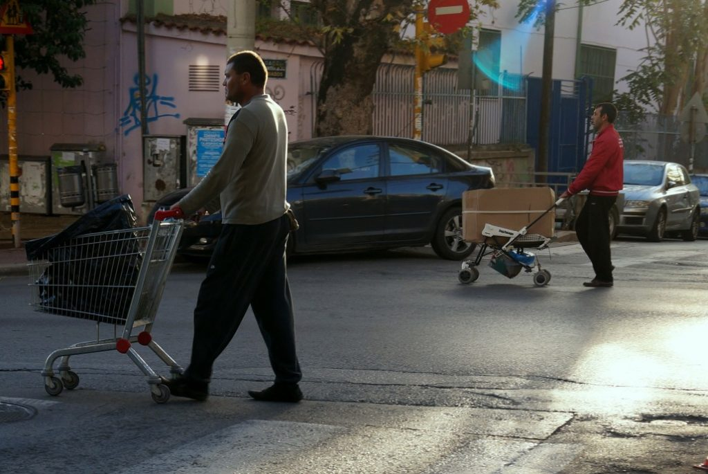 Greek crisis | Waste pickers walk along a street in the northern Greek port city of Thessaloniki looking for salvageable items in the city's rubbish.