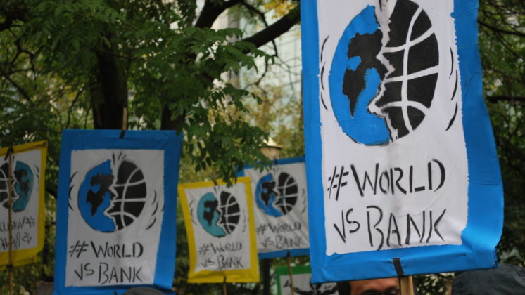 World Bank protest signs
