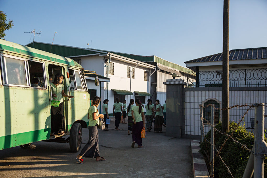 A shuttle bus drops of workers at Charming Garment Manufacturing in Yangon's Hlaing Tharyar industrial zone.