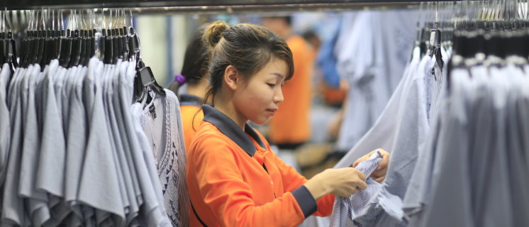 A young worker checks final products at a garment factory in Hưng Yên.